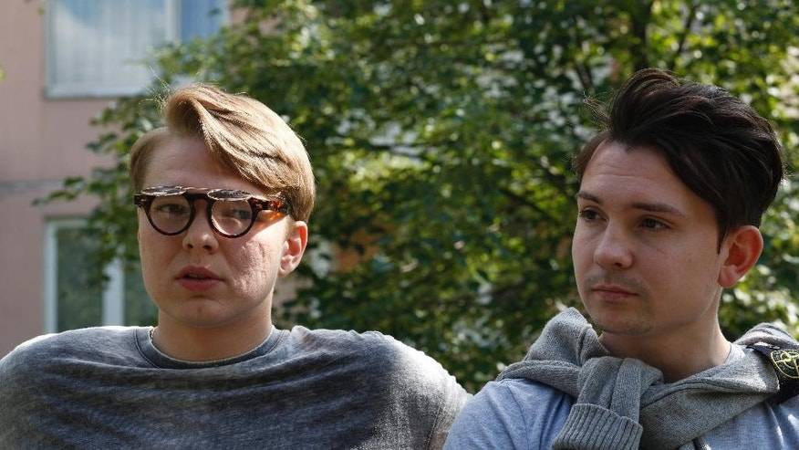 Video bloggers Artyom Frantsuzov, left, and Yevgeny Babenko, speak during an interview with the Associated Press in Moscow, Russia, Wednesday, July 15, 2015. Frantsuzov and Babenko, neither of whom are gay, made a video that depicted them as a couple, filmed by a hidden camera in public places, as a 'social experiment' to demonstrate how Russians react to homosexuality in public. (AP Photo/Alexander Zemlianichenko)