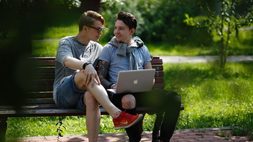 Video bloggers Artyom Frantsuzov, left, and Yevgeny Babenko, prepare for an interview with the Associated Press in Moscow, Russia, Wednesday, July 15, 2015. Frantsuzov and Babenko, neither of whom are gay, made a video that depicted them as a couple, filmed by a hidden camera in public places, as a 'social experiment' to demonstrate how Russians react to homosexuality in public. (AP Photo/Alexander Zemlianichenko)