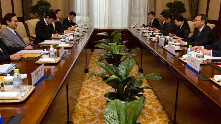 Japanese National Security Adviser Shotaro Yachi, attends a meeting with Chinese State Councilor Yang Jiechi, right, at the Diaoyutai State guesthouse in Beijing, Thursday, July 16, 2015. (AP Photo/Ng Han Guan, Pool)