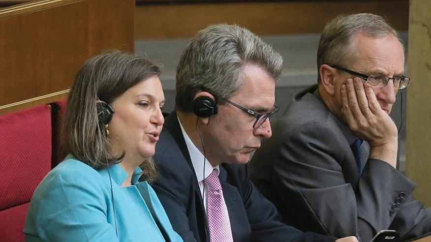 "U.S. Assistant Secretary of State Victoria Nuland, foreground,  listens, during a parliament session in Kiev, Ukraine Thursday, July 16, 2015. Ukraine's parliament, on Thursday sent to the Constitutional Court draft amendments to the country's Constitution concerning decentralization. A total of 288 lawmakers, 62 more than the minimum required voted in favor of the decision. The Constitution is added by a provision that ""the peculiarities of local self-government in certain areas of the Donetsk and Lugansk regions are defined by a separate law."" (AP Photo/Efrem Lukatsky)"