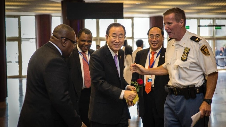 """United Nations Secretary-General Ban Ki-moon, center, arrives for the opening of  The Third International Conference on Financing for Development, held in Addis Ababa, Ethiopia Monday, July 13, 2015. According to the organizers, the conference which runs from July 13-16 is intended to gather world leaders to """"launch a renewed and strengthened global partnership for financing people-centered sustainable development"""". (AP Photo/Mulugeta Ayene)"""