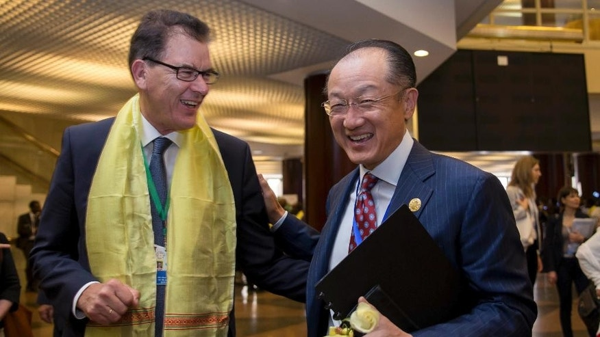 """President of the World Bank Dr. Jim Yong Kim, right, reacts with Germany's Federal Minister of Economic Cooperation and Development, Dr. Gerd Muller, at The Third International Conference on Financing for Development, held in Addis Ababa, Ethiopia, Monday, July 13, 2015. According to the organizers, the conference which runs from July 13-16 is intended to gather world leaders to """"launch a renewed and strengthened global partnership for financing people-centered sustainable development"""". (AP Photo/Mulugeta Ayene)"""