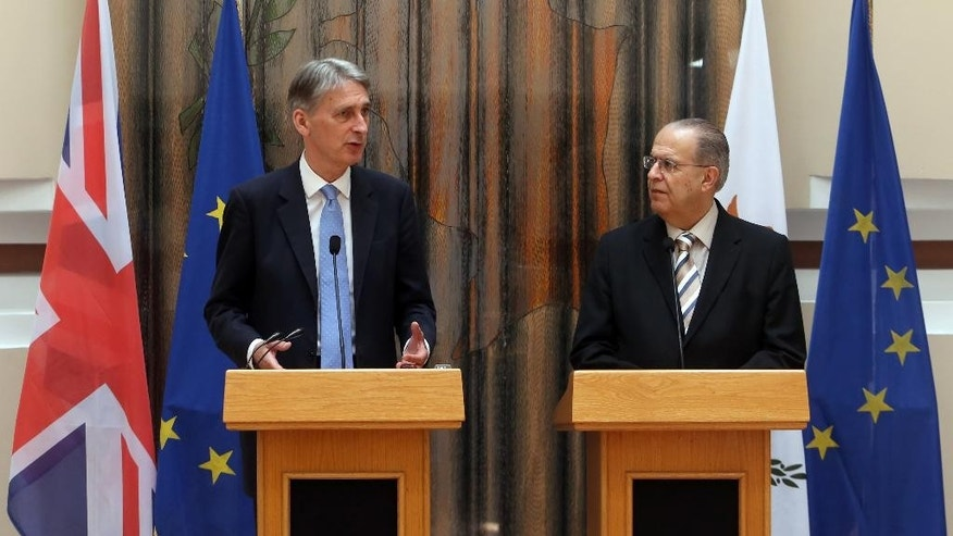 """British Foreign Secretary Philip Hammond, left, and Cypriot Foreign Minister Ioannis Kasoulides speaks to the media after their meeting at the Foreign Ministry in Nicosia, Cyprus, July 17, 2015. Hammond said Britain is """"keen to work"""" with Cyprus to counter the threat posed by """"foreign fighters going to Syria, Iraq and elsewhere."""" (AP Photos/Philippos Christou)"""