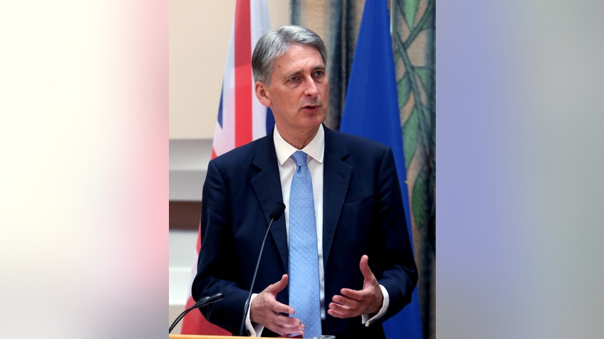 """British Foreign Secretary Philip Hammond speaks during a press conference after his meeting with Cypriot Foreign Minister Ioannis Kasoulides at the Foreign Ministry in Nicosia, Cyprus, July 17, 2015. Hammond said Britain is """"keen to work"""" with Cyprus to counter the threat posed by """"foreign fighters going to Syria, Iraq and elsewhere."""" (AP Photos/Philippos Christou)"""