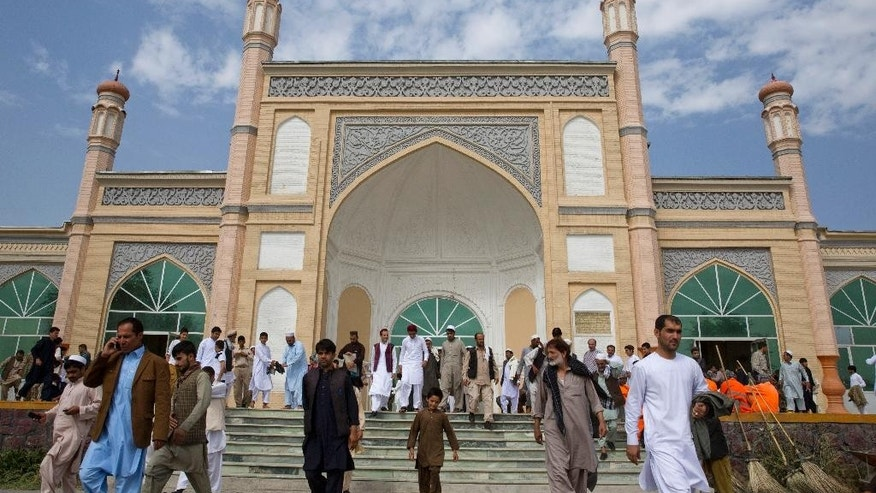 Afghan men leave after Eid Al-Fitr prayers in Eid Gah mosque in Kabul, Afghanistan, Friday, July 17, 2015. Eid al-Fitr prayer marks the end of the holy fasting month of Ramadan.(AP Photo/Massoud Hossaini)