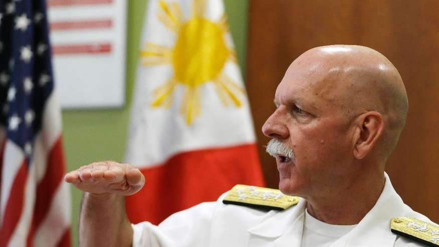 U.S. Pacific Fleet Commander Adm. Scott Swift gestures during an interview with journalists Friday, July 17, 2015 in Manila, Philippines.  The new U.S. commander of the Pacific Fleet has assured allies that American forces are well-equipped and ready to respond to any contingency in the South China Sea, where long-seething territorial disputes have set off widespread uncertainties. (AP Photo/Bullit Marquez)