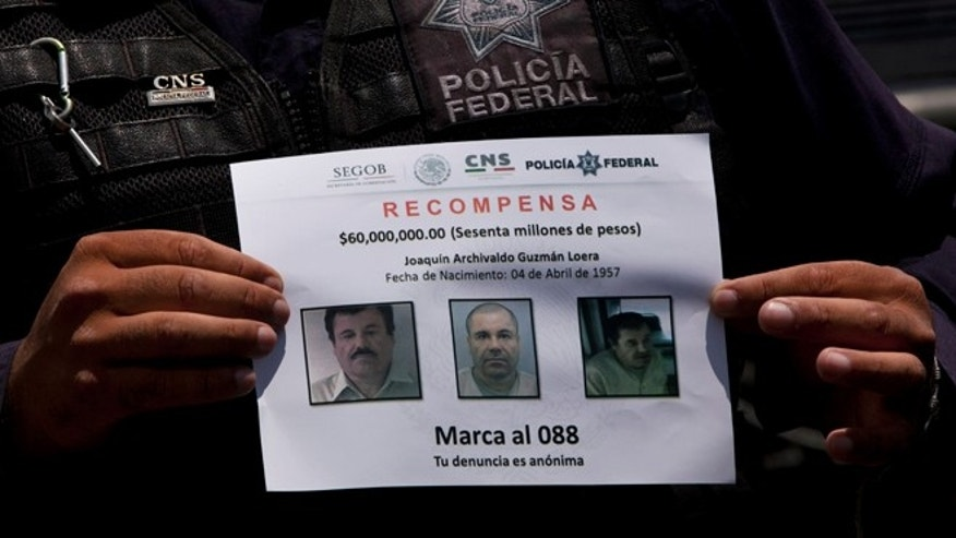 "In this July 16, 2015, photo, a Federal Police shows a reward notice for information leading to the capture of drug lord Joaquin ""El Chapo"" Guzman, who made his escape from the Altiplano maximum security prison via an underground tunnel,  in Almoloya, west of Mexico City. The Drug Enforcement Administration's deputy administrator says he is confident one of the world's most-wanted drug traffickers will be captured again after a brazen weekend escape from a maximum-security Mexican prison.  (AP Photo/Marco Ugarte)"