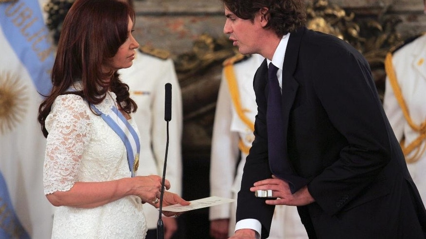 FILE - In this Dec. 10, 2007 file photo, Finance Minister Martin Lousteau, right, swears-in Argentina's new President Cristina Fernandez at the presidential palace in Buenos Aires, Argentina. Lousteau, who now opposes Fernandez's government, is running for Buenos Aires mayor in a July 19, 2015 run-off election, representing the ECO Party. (AP Photo/Emiliano Lasalvia, file)