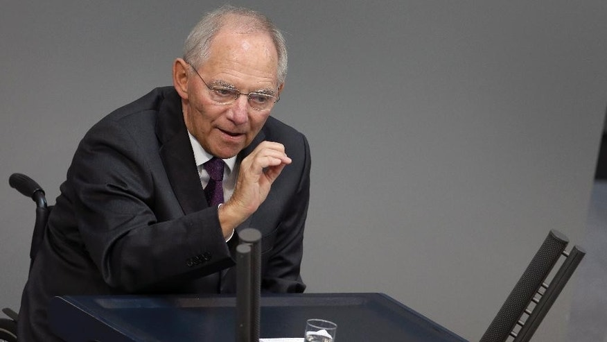German Finance Minister Wolfgang Schaeuble gestures during his speech as part of a meeting of the German federal parliament, Bundestag, in Berlin, Germany, Friday, July 17, 2015. German lawmakers will vote on a third bailout package for Greece later on Friday. (AP Photo/Michael Sohn)