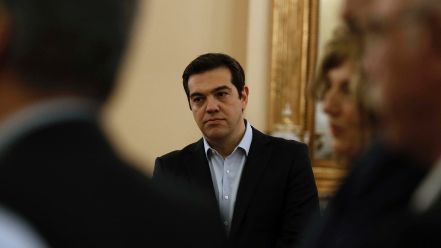 July 18, 2015: Greece's Prime Minister Alexis Tsipras attends the swearing in ceremony of his new ministers at the Presidential Palace in Athens.