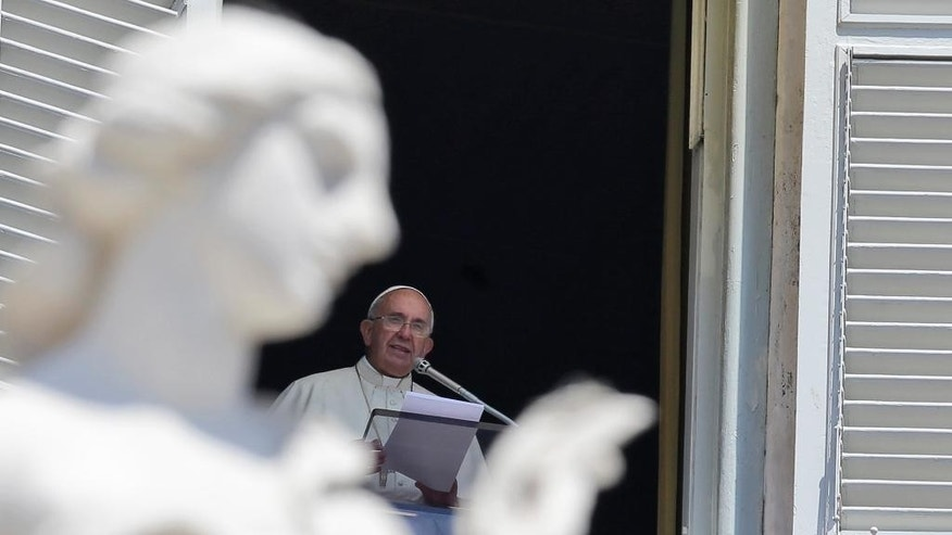 "Pope Francis delivers his message during the Angelus noon prayer he delivered from his studio's window, in St. Peter's Square, at the Vatican, Sunday, July 19, 2015. Speaking from his studio window, Francis told the crowd Sunday in St. Peter's Square: ""I see you are courageous with this heat in the square. A tip of the hat to you!"" Many faithful used sun umbrellas. Temperatures in Rome this week could hit 38-39C (100-102F). Sizzling heat and oppressive humidity have gripped Italy this month, with some nights in Rome seeing ""low"" temperatures hovering near 30C (86F). (AP Photo/Gregorio Borgia)"