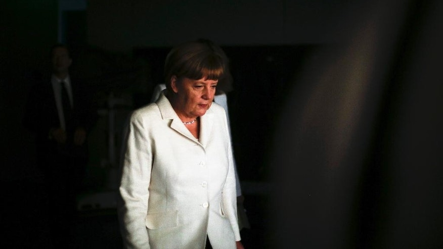 German Chancellor Angela Merkel arrives for an interview at the TV  studios of German public broadcaster ARD  in Berlin, Germany, Sunday, July 19, 2015. (AP Photo/Markus Schreiber)