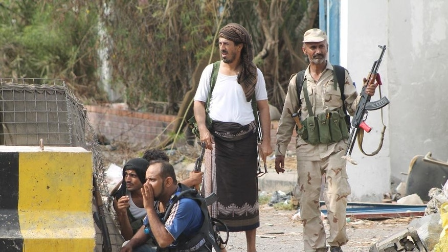 Fighters against Shiite rebels known as Houthis gather at the frontline of fighting against Houthis fighters in the port city of Aden, Yemen, Thursday, July 16, 2015. Saudi-backed Yemeni troops and fighters have driven Shiite rebels out of two major neighborhoods in the southern port city of Aden, Thursday, prompting street celebrations by residents after weeks of fierce fighting. (AP Photo/Abo Muhammed)