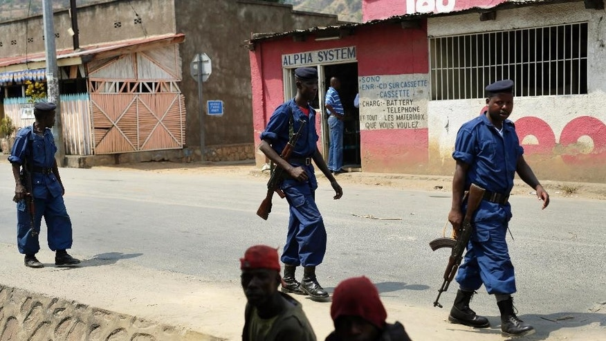 Policemen patrol the Musaga district of  Bujumbura, Burundi, Monday July 20, 2015. Government representatives failed to show up Sunday for talks in Burundi aimed at ending the unrest caused by the president's controversial bid for a third term, forcing the mediation to be adjourned just ahead of Tuesday's election, the talks facilitator said. Burundi has been rocked by violence that has left more than 100 people dead. Over 144,000 people have fled the country since the ruling party announced President Pierre Nkurunziza's candidacy in April.  (AP Photo/Jerome Delay)