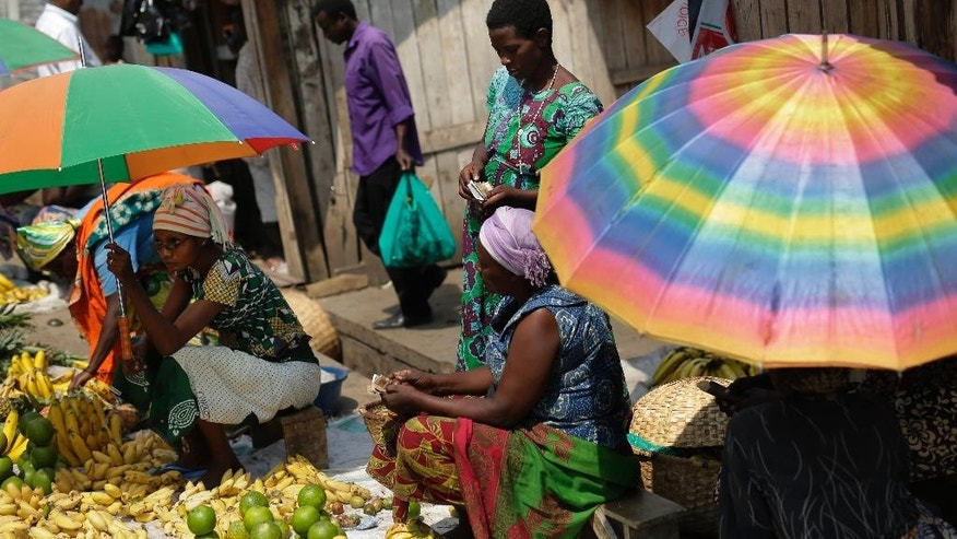 Women sell fruits at the market in the Musaga district of  Bujumbura, Burundi, Monday July 20, 2015. Government representatives failed to show up Sunday for talks in Burundi aimed at ending the unrest caused by the president's controversial bid for a third term, forcing the mediation to be adjourned just ahead of Tuesday's election, the talks facilitator said. Burundi has been rocked by violence that has left more than 100 people dead. Over 144,000 people have fled the country since the ruling party announced President Pierre Nkurunziza's candidacy in April. (AP Photo/Jerome Delay)