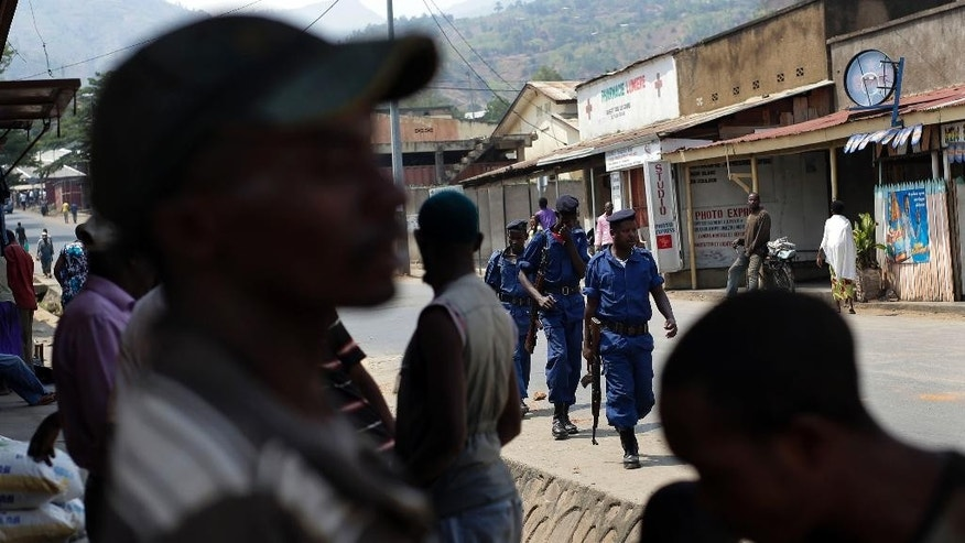 Policemen patrol the Musaga district of  Bujumbura, Burundi, Monday July 20, 2015. Government representatives failed to show up Sunday for talks in Burundi aimed at ending the unrest caused by the president's controversial bid for a third term, forcing the mediation to be adjourned just ahead of Tuesday's election, the talks facilitator said. Burundi has been rocked by violence that has left more than 100 people dead. Over 144,000 people have fled the country since the ruling party announced President Pierre Nkurunziza's candidacy in April. ( AP Photo/Jerome Delay)