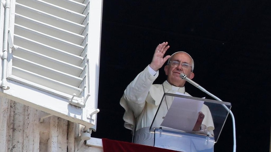 "Pope Francis delivers a blessing during the Angelus noon prayer he delivered from his studio's window, in St. Peter's Square, at the Vatican, Sunday, July 19, 2015. Speaking from his studio window, Francis told the crowd Sunday in St. Peter's Square: ""I see you are courageous with this heat in the square. A tip of the hat to you!"" Many faithful used sun umbrellas. Temperatures in Rome this week could hit 38-39C (100-102F). Sizzling heat and oppressive humidity have gripped Italy this month, with some nights in Rome seeing ""low"" temperatures hovering near 30C (86F). (AP Photo/Gregorio Borgia)"