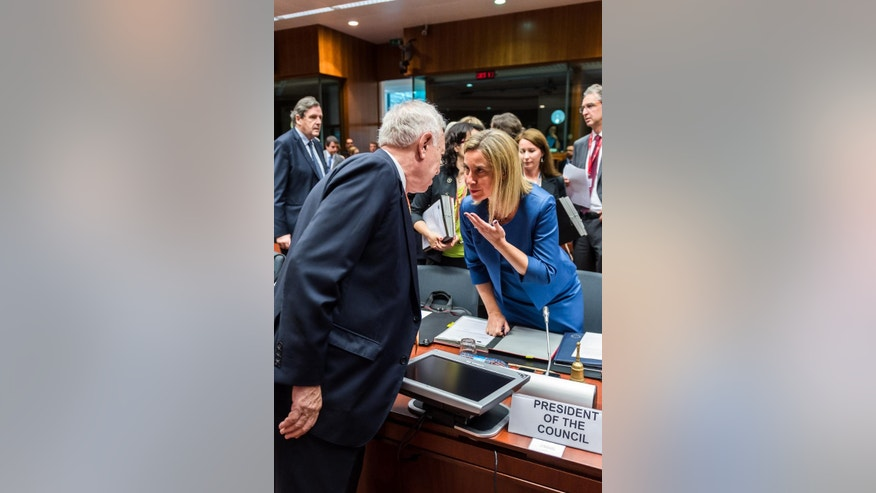 Spanish Foreign Minister Jose Manuel Garcia-Margallo, left, talks with European Union High Representative Federica Mogherini during a meeting of EU foreign ministers at the EU Council building in Brussels on Monday July 20, 2015. (AP Photo/Geert Vanden Wijngaert)