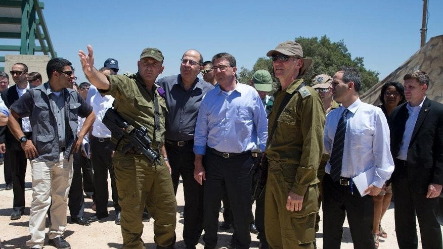 From left, Israel Defense Forces (IDF) 91st Division Commander Moni Katz, directing his right arm foward, from left, Israeli Defense Minister Moshe Ya'alon, U.S. Defense Secretary Ash Carter and Deputy Chief of Staff Maj. Gen. Yair Golan pause as they walk from viewing Hula Valley from the Hussein Lookout, behind them, near Kiryat Shmona, Israel, Monday, July 20, 2015, in northern Israel along the boarder with Lebanon. Carter said he has no expectation of persuading Israeli leaders to drop their opposition to the Iran nuclear deal, but will instead emphasize that the accord imposes no limits on what Washington can do to ensure the security of Israel and U.S. Arab allies. (AP Photo/Carolyn Kaster, Pool)