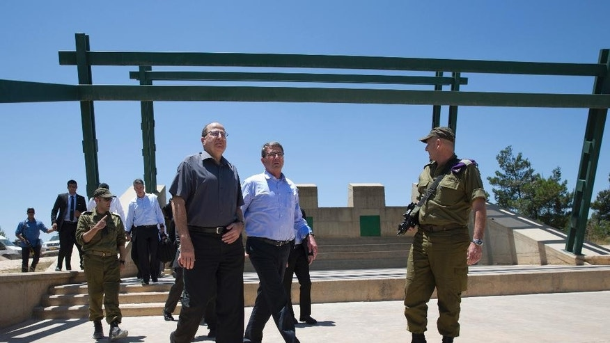 U.S. Defense Secretary Ash Carter, center, and Israeli Defense Minister Moshe Ya'alon arrive with Israel Defense Forces (IDF) 91st Division Commander Moni Katz, right, to view the Hula Valley from the Hussein Lookout near Kiryat Shmona, Israel, Monday, July 20, 2015, in norther Israel along the boarder with Lebanon.  Carter said he has no expectation of persuading Israeli leaders to drop their opposition to the Iran nuclear deal, but will instead emphasize that the accord imposes no limits on what Washington can do to ensure the security of Israel and U.S. Arab allies. (AP Photo/Carolyn Kaster, Pool)