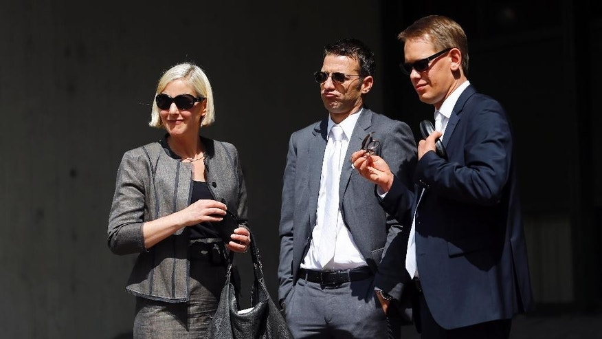 Lawyers of defendant Beate Zschaepe, alleged member of the neo-Nazi group National Socialist Underground, NSU, from left :  Anja Sturm,  Wolfgang Stahl and Wolfgang Heer leave the court in Munich, Germany, Monday, July 20, 2015. The three court-appointed  lawyers for the sole surviving suspect in Germany's biggest neo-Nazi murder trial have asked the court for permission to resign.  (AP Photo/Matthias Schrader)