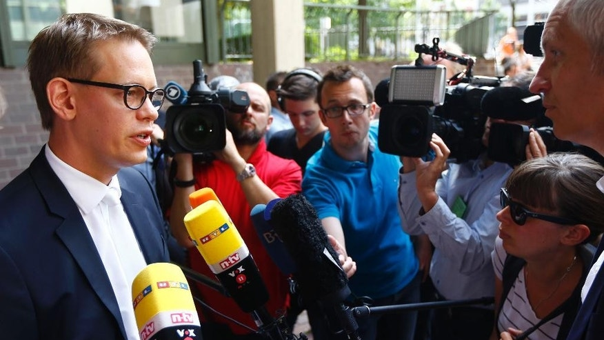 Lawyer of defendant Beate Zschaepe, alleged member of the neo-Nazi group National Socialist Underground, NSU, Wolfgang Heer answers questions of journalists in front of a court in Munich, Germany, Monday, July 20, 2015. Tthree court-appointed  lawyers for the sole surviving suspect in Germany's biggest neo-Nazi murder trial have asked the court for permission to resign. (AP Photo/Matthias Schrader)