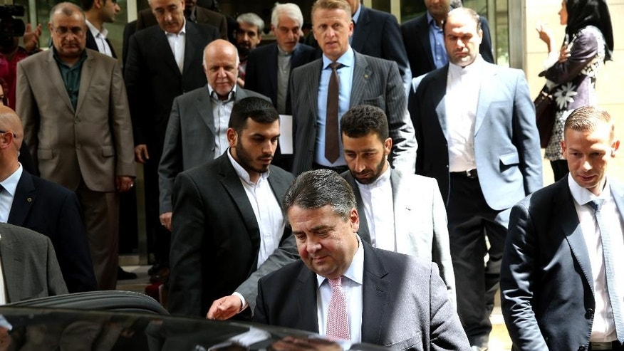 German Vice Chancellor and Economy Minister Sigmar Gabriel, center, leaves after his meeting with Iranian Oil Minister Bijan Zanganeh in Tehran, Iran, Monday, July 20, 2015. (AP Photo/Ebrahim Noroozi)