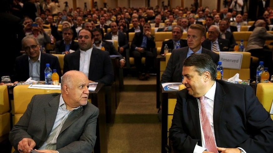 German Vice Chancellor and Economy Minister Sigmar Gabriel, right, and Iranian Oil Minister Bijan Zanganeh, speaks during a conference in Tehran, Iran, Monday, July 20, 2015. (AP Photo/Ebrahim Noroozi)