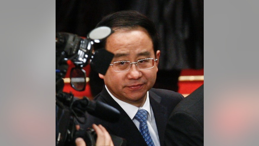 FILE - In this Wednesday March 14, 2012, file photo, Ling Jihua, a loyal aide and confidante to President Hu Jintao looks on as he attends the closing ceremony of the National People's Congress at the Great Hall of the People in Beijing. China's state media say former President Hu Jintao's top aide has been stripped of his party membership, removed from all government positions, and will be criminally prosecuted on corruption charges. The official Xinhua News Agency said Monday, July 20, 2015 that an internal investigation found that Ling, who once served as head of the Communist Party's general office, took huge bribes and used his position to seek benefits for others. (AP Photo/Andy Wong, File)