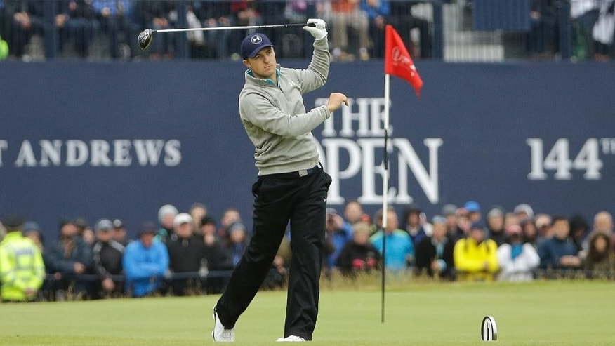 United States' Jordan Spieth makes a wayward drive from the 18th tee during the final round at the British Open Golf Championship at the Old Course, St. Andrews, Scotland, Monday, July 20, 2015.  (AP Photo/David J. Phillip)