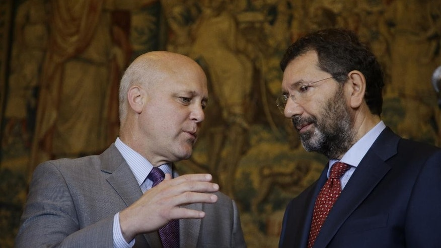 New Orleans Mayor Mitch Landrieu and Rome Mayor Ignazio Marino, right, attend a press conference after a meeting in Rome Monday, July 20, 2015. Dozens of environmentally friendly mayors from around the world are meeting at the Vatican this week to bask in the star power of eco-Pope Francis and commit to reducing global warming and helping the urban poor deal with its effects. (AP Photo/Gregorio Borgia)