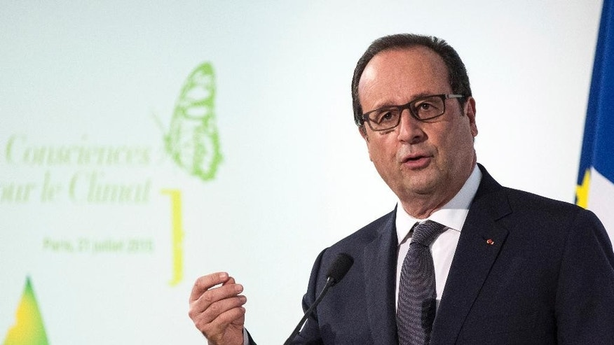 French President Francois Hollande delivers a speech during the opening of the Consciouness Summit in Paris, France, Tuesday, July 21, 2015. French president Francois Hollande called for an ambitious accord on climate ahead of a UN conference in Paris to address the threat of global warning. (Etienne Laurent/Pool Photo via AP)