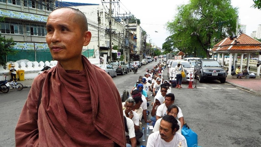 In this Monday July 20, 2015 photo, Dadodin Patavatto a Buddhist monk, leads a silent march to the Prime Minister's office in Bangkok to demonstrate against a proposed coal power plant in southern Thailand. The popular tourist beaches near southern Thailand's Andaman Coast may soon play host to an unlikely new fixture: an 800-megawatt coal power plant. The plans have sparked an outcry in the typically tranquil Krabi province, famed for its white sand and picturesque limestone cliffs. (AP Photo/Ted Andersen)