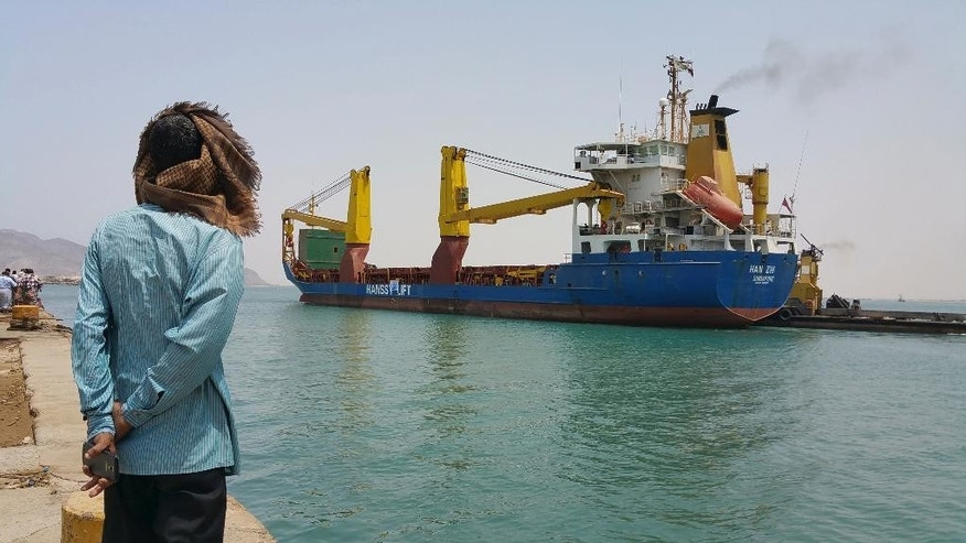 A Yemeni man looks at a World Food Program ship at the port of Aden, Yemen, Tuesday, July 21, 2015. The WFP ship carrying badly needed aid arrived in Yemen's war-torn southern city of Aden on Tuesday, the first vessel chartered by the U.N. agency to berth there since Saudi-led airstrikes on Shiite rebels in the country began in March. (AP Photo/Ahmed Sameer)