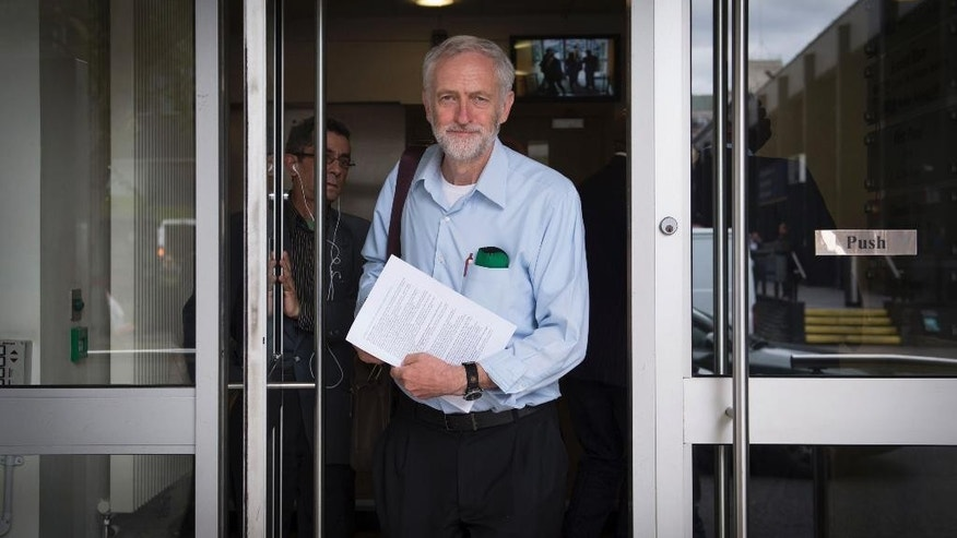 Contender for leader of Britain's Labour party Jeremy Corbyn outside his campaign headquarters in north London, Wednesday July 22, 2015.  Labour is seeking a new leader to rebuild the party after losing May's General Election to the Conservative party, and left-wing candidate Corbyn's message seems to have found strong support among party members, according to media reports Wednesday. (Stefan Rousseau / PA via AP) UNITED KINGDOM OUT - NO SALES - NO ARCHIVES