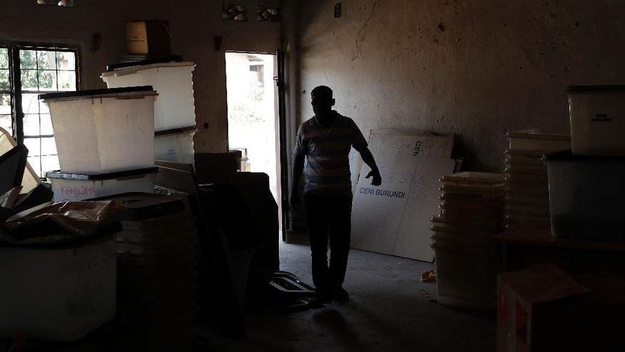 A local administrator walks into a room where tallied ballots from the presidential elections are being stored in Bujumbura, Burundi, Wednesday July 22, 2015. The head of Burundi's electoral commission says vote counting is underway and results are expected Thursday for a controversial election in which incumbent President Pierre Nkurunziza's bid for a third term in power has sparked widespread unrest.(AP Photo/Jerome Delay)