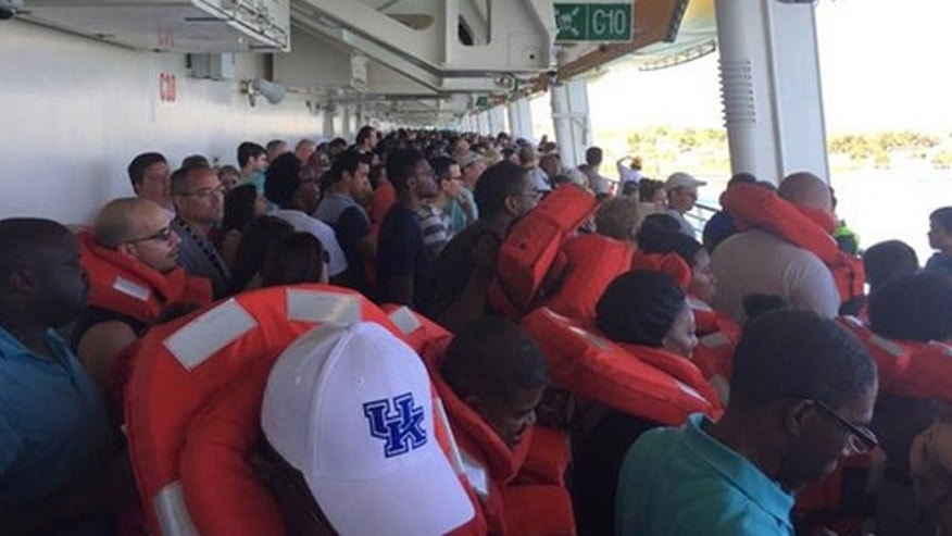 Passengers assemble after a fire broke out in a mechanical space on the cruise, Freedom of the Seas