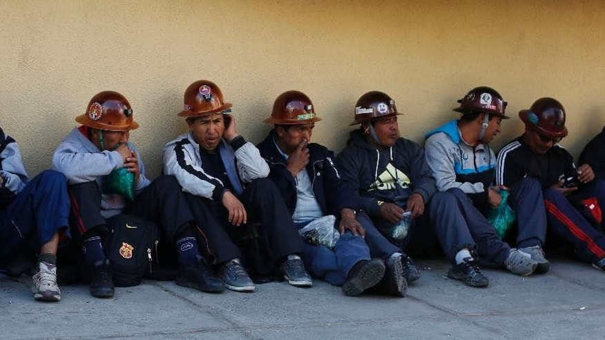 Miners from Bolivia's Potosi region wait as their representatives dialogue with the government, before they broke off the talks in La Paz, Bolivia, Wednesday, July 22, 2015. Residents in the capital city of Potosi have held a general strike for more than two weeks to pressure the national government to respond to their demands for a better hospital, an operable airport and a cement factory, among other things to revamp the economy. (AP Photo/Juan Karita)