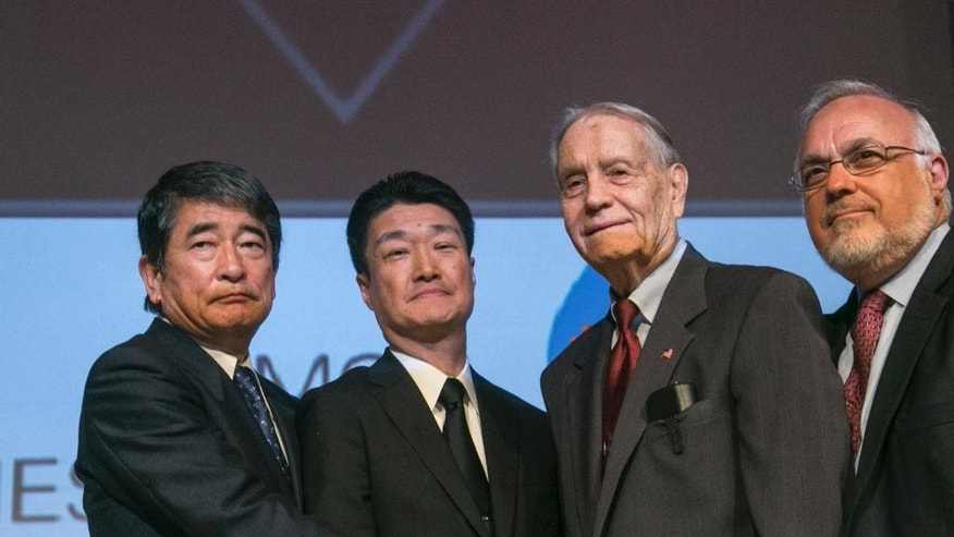 Yukio Okamoto, Outside Board Member of Mitsubishi Materials and former Special Advisor to Japan's Prime Minister, left, and Hikaru Kimura, Senior Executive Officer Mitsubishi Materials, offer an apology as they hold hands with 94-year-old U.S. prisoner of war, James Murphy, at the Simon Wiesenthal Center in Los Angeles, Sunday, July 19, 2015. Some 12,000 American prisoners were shipped to Japan and forced to work at more than 50 sites to support imperial Japan's war effort, and about 10 percent died, according to Kinue Tokudome, director of the U.S.-Japan Dialogue on POWs, who has spearheaded the lobbying effort for companies to apologize. (AP Photo/Damian Dovarganes)
