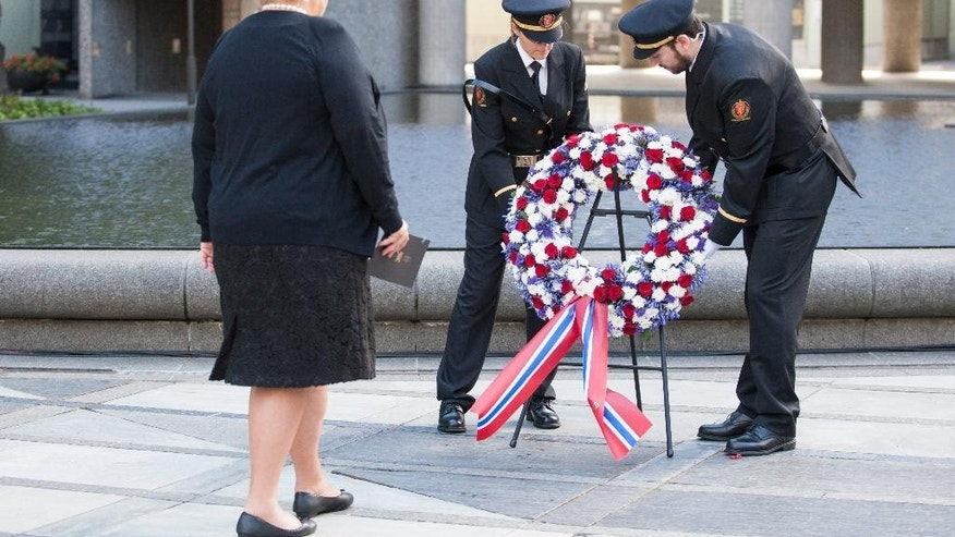 Norwegian Prime Minister Erna Solberg takes part in a wreath laying at a memorial ceremony as Norway marked the fourth anniversary of the bombing and the shootings at the Labor Party youth camp on Utoeya island, which killed in total 77 people.