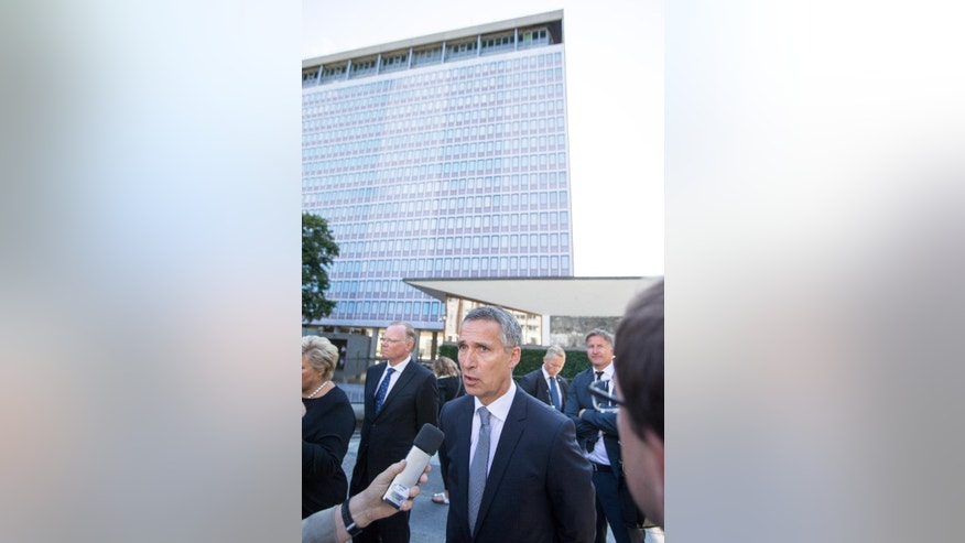NATO Secretary General, Jens Stoltenberg, speaks to the press at a memorial ceremony taking place Wednesday, July 22, 2015, near the government building damaged by the bomb attack in Oslo which took place on July 22, 2011. Norway marked the fourth anniversary of the bombing and the shootings at the Labor Party youth camp on Utoeya island, which killed in total 77 people. (Audun Braastad/NTB scanpix via AP)  NORWAY OUT