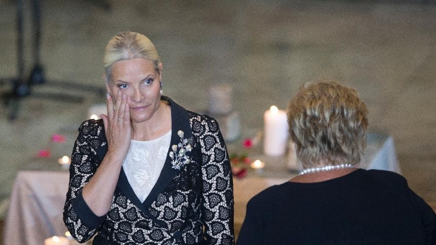 Crown Princess Mette-Marit of Norway attends the memorial service for the victims of Anders Behring Breivik taking place in Oslo Cathedral Wednesday, July 22, 2015. Norway marked the fourth anniversary of the bombing of the government buildings in Oslo, and shooting at the Labor Party youth camp on Utoeya island, killing in total 77 people. (Torstein Boe/NTB scanpix via AP)  NORWAY OUT