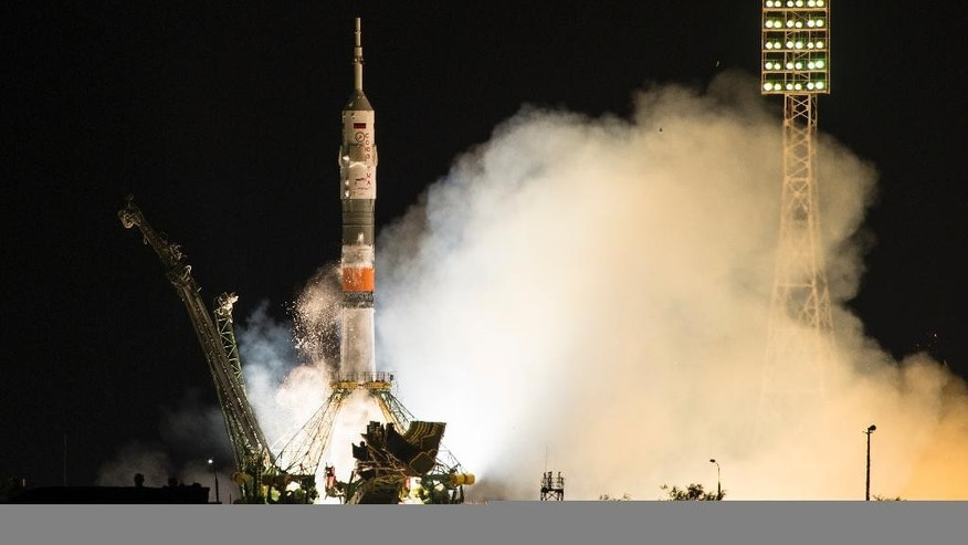 The Soyuz-FG booster rocket with the space capsule Soyuz TMA-14M launched to the International Space Station from the Russian leased Baikonur cosmodrome, Kazakhstan, in Kazakhstan, early Thursday, July 23, 2015. The Russian rocket carries Russian cosmonaut Oleg Kononenko, U.S. astronaut Kjell Lindgen and Japan astronaut Kimiya Yui. (AP Photo/Pavel Golovkin)
