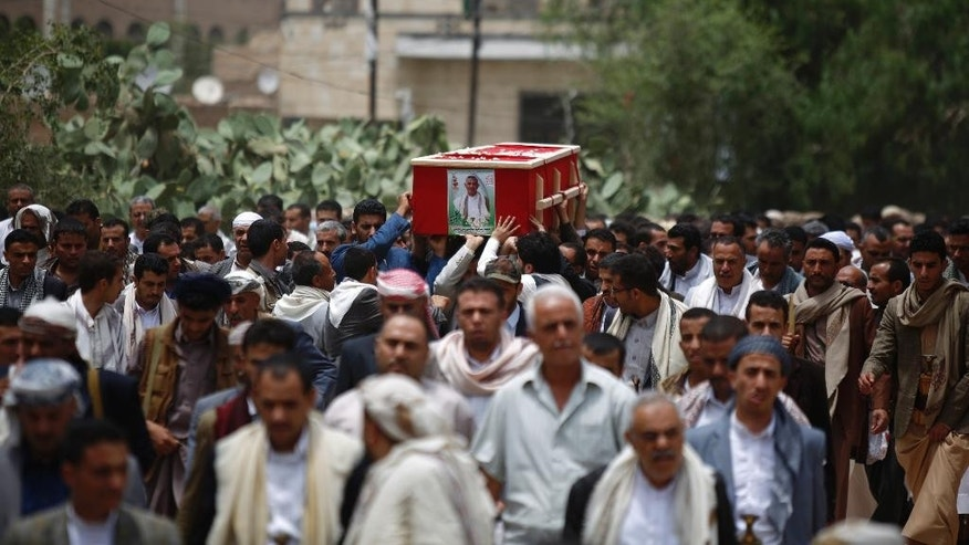 Shiite rebels known as Houthis carry a coffin of a fellow Houthi who was killed in a recent a car bomb attack, during his funeral in Sanaa, Yemen, Wednesday, July 22, 2015. (AP Photo/Hani Mohammed)