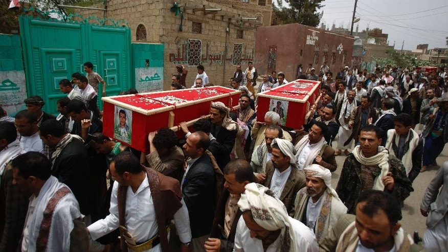 Shiite rebels known as Houthis carry the coffins of fellow Houthis, who were killed in a recent a car bomb attack, during their funeral in Sanaa, Yemen, Wednesday, July 22, 2015. (AP Photo/Hani Mohammed)