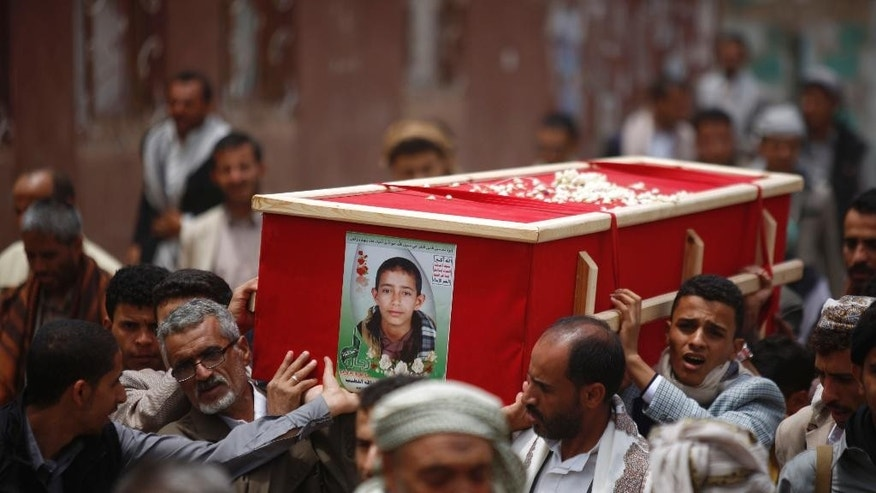 Shiite rebels known as Houthis carry a coffin of a fellow Houthi, who was killed in a recent a car bomb attack, during his funeral in Sanaa, Yemen, Wednesday, July 22, 2015. (AP Photo/Hani Mohammed)