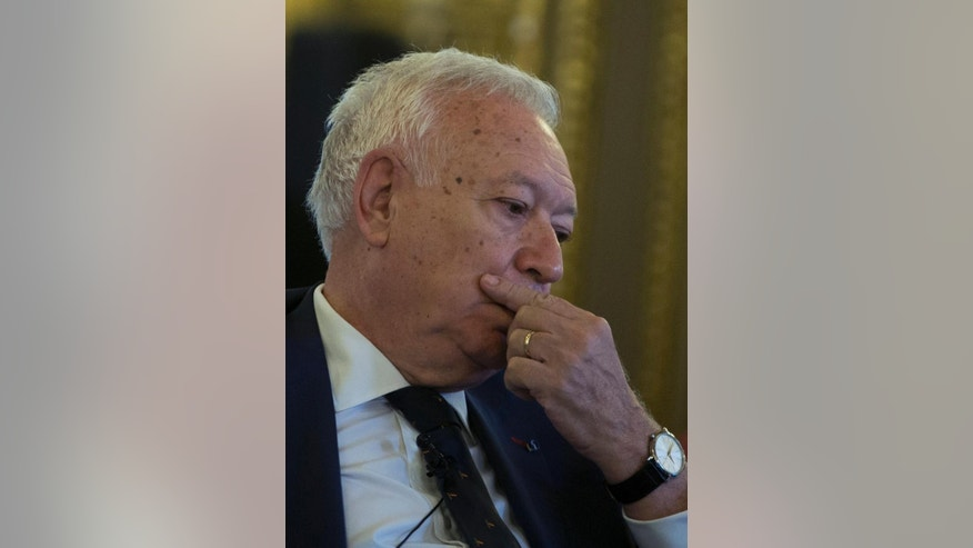 Spain's Foreign Minister Jose Manuel Garcia-Margallo pauses after speaking about three missing Spanish journalists in Syria, during a press conference in Madrid, Spain, Wednesday, July 22, 2015. Spain says it is trying to establish what happened to three Spanish freelance journalists reported to have gone missing around the embattled northern Syrian city of Aleppo and that it will contact the government in Damascus over the case. (AP Photo/Paul White)