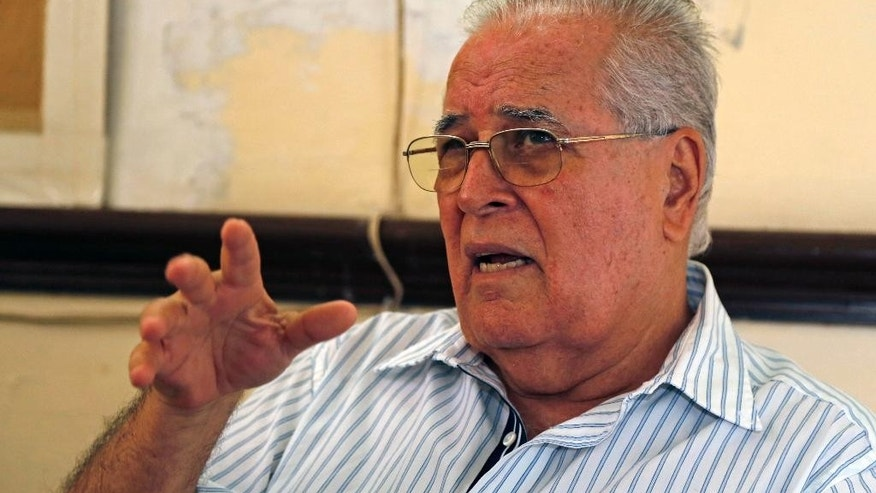 In this July 2, 2015 photo, dissident Elizardo Sanchez, president of the Cuban Commission for Human Rights and National Reconciliation, answers question during an interview in his home in Havana, Cuba. Many of the dissidents are feeling increasingly sidelined and abandoned as both countries celebrate milestones like Monday's opening of embassies in Havana and Washington. (AP Photo/Desmond Boylan)