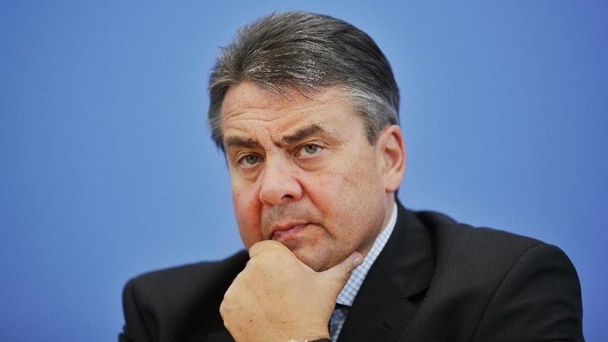 German Vice Chancellor and Economy Minister Sigmar Gabriel briefs the media on his last week's visit in Iran during a news conference in Berlin, Germany, Thursday, July 23, 2015. (AP Photo/Markus Schreiber)