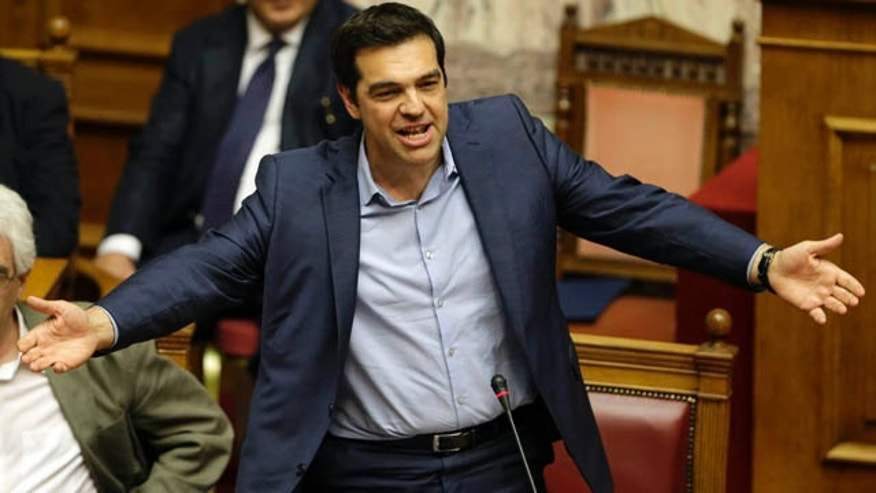 July 23, 2015: Greece's Prime Minister Alexis Tsipras speaks during an emergency parliament session in Athens. Greek lawmakers approved further reforms demanded by international creditors in return for a third multi-billion-euro bailout. (AP Photo/Thanassis Stavrakis)